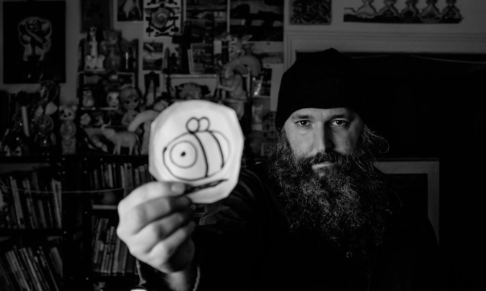 BW photo of Steven Cerio with Bee drawing by Christopher Molloy